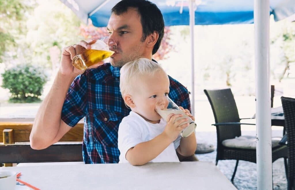 baby and dad drinking